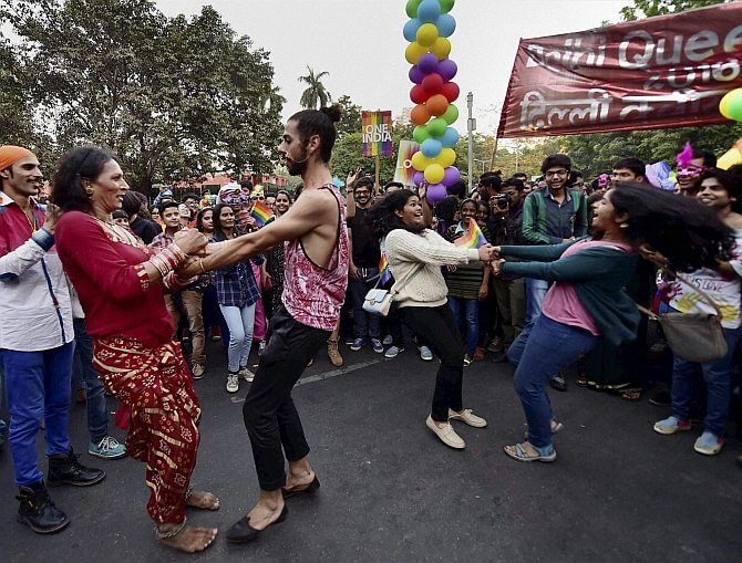 New Delhi: LGBT Community members and supporters dance during the Delhi Queer Pride March in New Delhi on Sunday. PTI Photo by Kamal Singh (PTI11_27_2016_000180B)